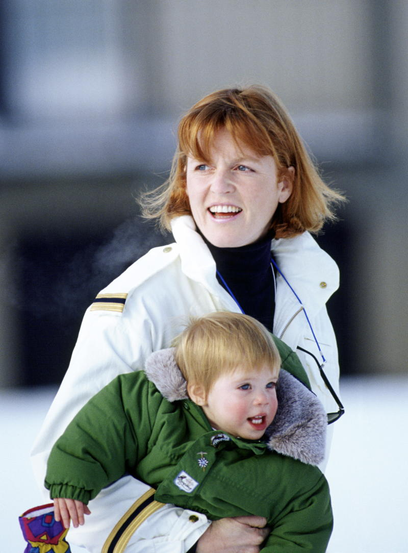 Sarah Ferguson pictured carrying Princess Eugenie during a skiing holiday in 1992. [Photo: Getty]