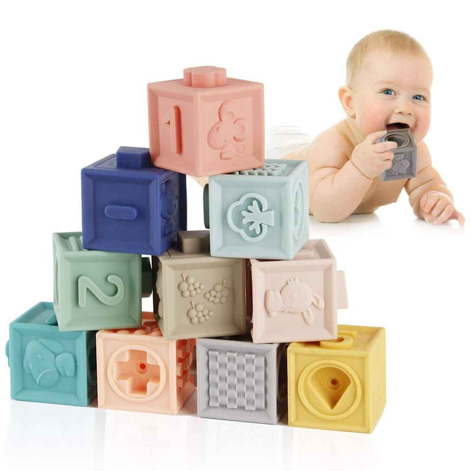 <p>These supersquishy <span>Mini Tudou Baby Blocks Soft Building </span> ($20) come in a set of 18 and are embossed with photos of animals, numbers, and letters. </p>