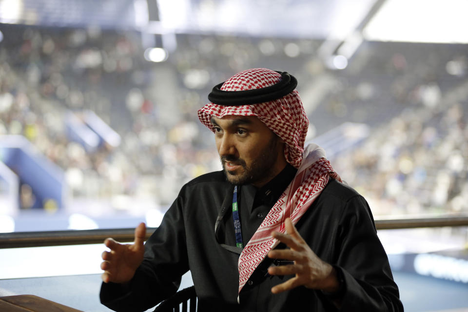 In this Friday, Dec. 13, 2019 photo, Prince Abdulaziz bin Turki al-Faisal, who leads the General Sports Authority, speaks during an interview with the Associated Press in Riyadh, Saudi Arabia. The Prince said that he invites anyone who's interested or curious about Saudi Arabia to come and visit the country after it opened tourist visas to people from around the world three months ago.(AP Photo/Amr Nabil)