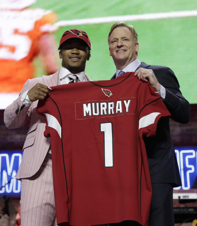 Oklahoma quarterback Kyler Murray poses with NFL Commissioner Roger Goodell after the Arizona Cardinals selected Murray in the first round at the NFL football draft, Thursday, April 25, 2019, in Nashville, Tenn. (AP Photo/Mark Humphrey)