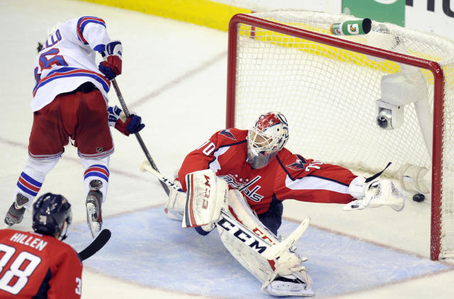 New York Rangers right wing Mats Zuccarello, left, from Norway, scores a goal against Washington Capitals goalie Braden Holtby (70) during the third period of Game 7 first-round NHL Stanley Cup playoff hockey series, Monday, May 13, 2013, in Washington. The Rangers won 5-0. (AP Photo/Nick Wass)