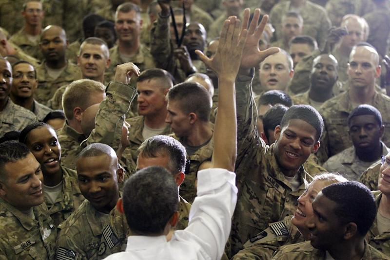 President Barack Obama gets a high five as he greets troops at Bagram Air Field, Afghanistan, Wednesday, May 2, 2012. (AP Photo/Charles Dharapak)