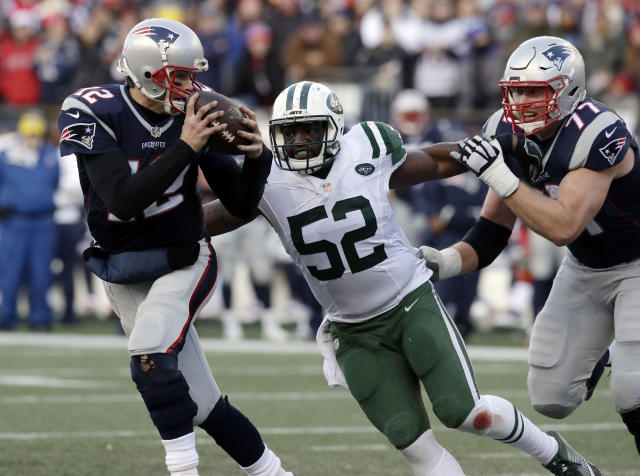 FILE - In this Dec. 24, 2016, file photo, New England Patriots quarterback Tom Brady (12) runs from New York Jets linebacker David Harris (52) during the second half of an NFL football game in Foxborough, Mass. Former Jets player Harris has retired after 11 NFL seasons. He made the announcement in a statement released on Twitter by his agents. (AP Photo/Charles Krupa, File)