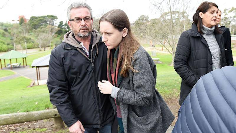 Borce Ristevski (centre right) the husband of Karen Ristevski and their daughter, Sarah, leave a press conference after pleading for information. Photo: AAP