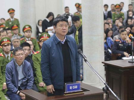 Vietnam's formmer Communist Party Politburo member and former chairman of PetroVietnam Dinh La Thang (front) stands as PVC's former chairman Trinh Xuan Thanh (L) sits at the court in Hanoi, Vietnam January 8, 2018. VNA/Doan Tan via REUTERS/Files