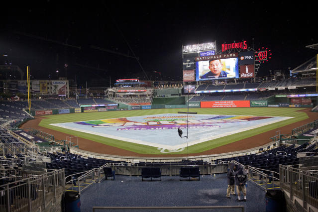 Tarp covers the infield during a rain delay during an interleague baseball game between the New York Yankees and Washington Nationals at Nationals Park, Tuesday, May 15, 2018, in Washington. The game was tied at 3-all when it was suspended due to a severe storms. The two teams will resume play tomorrow as part of a double-header. (AP Photo/Pablo Martinez Monsivais)
