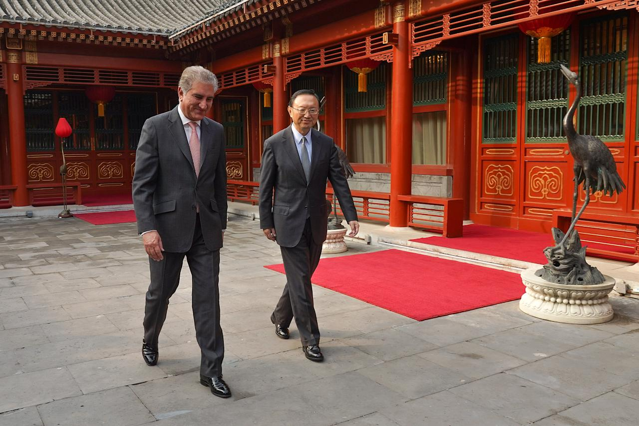 Chinese Director of the Central Foreign Affairs Commission Office Yang Jiechi and Pakistani Foreign Minister Shah Mehmood Qureshi walk to the meeting room at Diaoyutai State Guesthouse on March 20, 2019 in Beijing, China. Andrea Verdelli/Pool via REUTERS