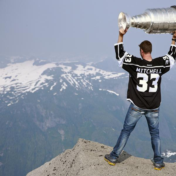 PORT MCNEILL, CANADA - AUGUST 12: Willie Mitchell #33 of the Los Angeles Kings holds up the Stanley Cup at the top of Mount Benedict August 12, 2012 near Port McNeill, British Columbia, Canada. Mitchell took the Stanley Cup to his hometown of Port McNeill, B.C. for his one-day celebration with the prized trophy. (Photo by Jeff Vinnick/NHLI via Getty Images)