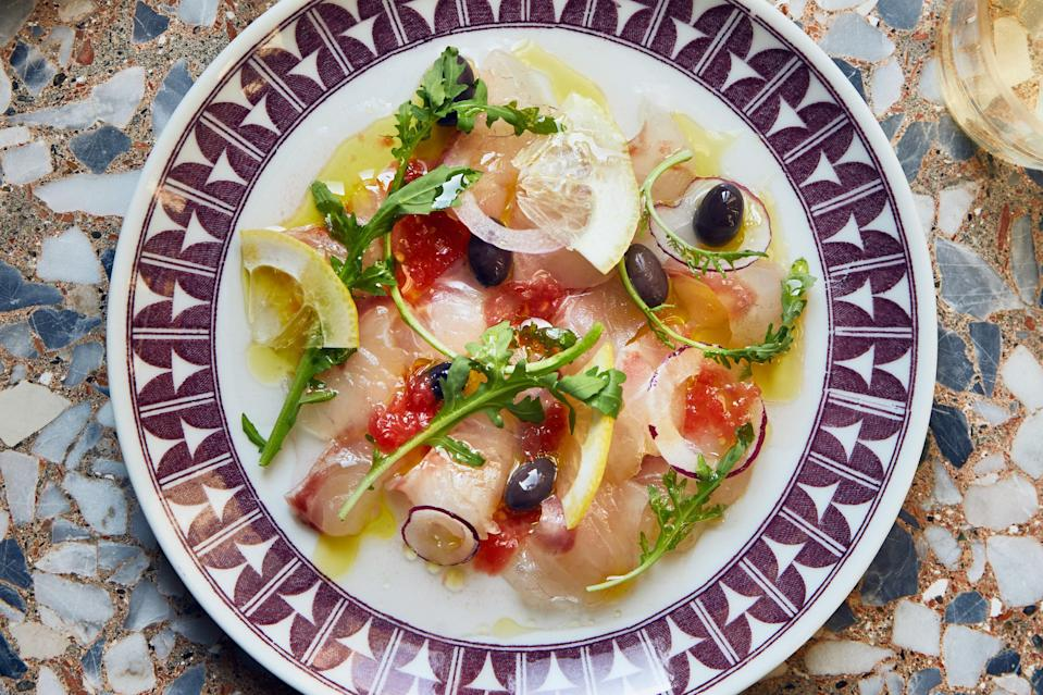 """Looking for refreshing appetizer recipes? Raw seafood is the answer. Sea bream is lovely here, but you can also use porgy or snapper. <a href=""""https://www.epicurious.com/recipes/food/views/sea-bream-crudo-with-lemon-and-olives?mbid=synd_yahoo_rss"""" rel=""""nofollow noopener"""" target=""""_blank"""" data-ylk=""""slk:See recipe."""" class=""""link rapid-noclick-resp"""">See recipe.</a>"""