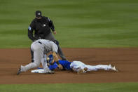 New York Yankees shortstop Gleyber Torres, left, loses the ball as Toronto Blue Jays' Cavan Biggio, right, reaches second on a fielding error by first baseman Luke Voit after a pickoff attempt during the fourth inning of a baseball game in Buffalo, N.Y., Wednesday, Sept. 23, 2020. (AP Photo/Adrian Kraus)