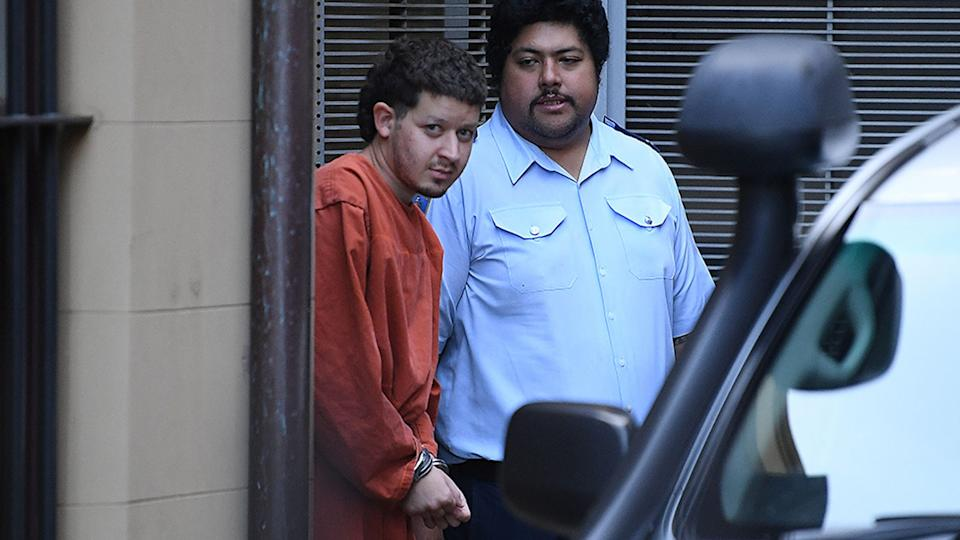 Mert Ney is led to a Corrective Services transport vehicle at the NSW Supreme Court in Sydney, Tuesday, March 30, 2021.