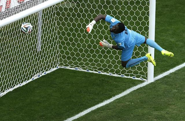 Ghana's goalkeeper Fatawu Dauda makes a save during the group G World Cup soccer match between Portugal and Ghana at the Estadio Nacional in Brasilia, Brazil, Thursday, June 26, 2014. (AP Photo/Themba Hadebe)