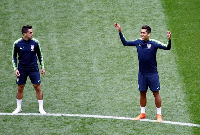 Soccer Football - World Cup - Brazil Training - Saint Petersburg Stadium, Saint Petersburg, Russia - June 21, 2018 Brazil's Roberto Firmino and Fagner during training REUTERS/Anton Vaganov