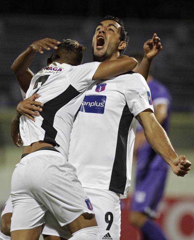 Juan Vogliotti of Venezuela's Monagas, right, celebrates with teammate Yanowsky Reyes after scoring against Uruguay's Defensor Sporting at a Copa Libertadores soccer match in Montevideo, Uruguay, Tuesday, April 17, 2018. (AP Photo/Matilde Campodonico)