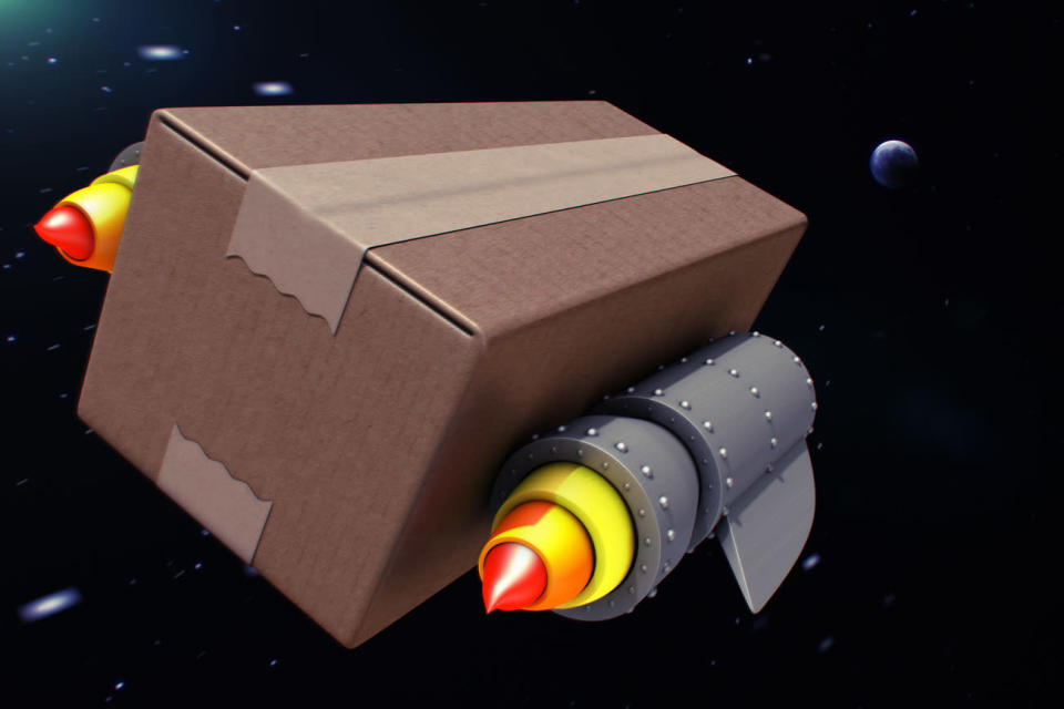 a cardboard box flies through outer space propelled by two thruster rockets