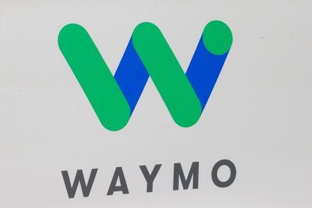 The Waymo logo is displayed during the company's unveil of a self-driving Chrysler Pacifica minivan during the North American International Auto Show in Detroit