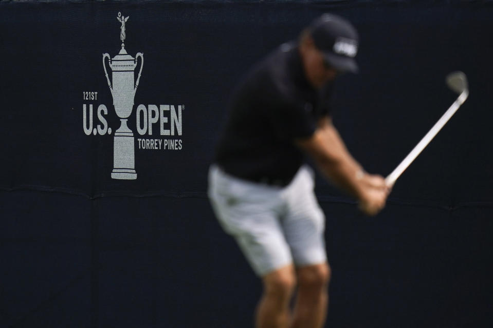 Phil Mickelson chips a shot on the 13th hole during a practice round of the U.S. Open Golf Championship Monday, June 14, 2021, at Torrey Pines Golf Course in San Diego. (AP Photo/Gregory Bull)