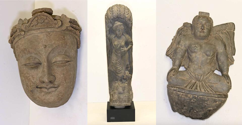 Recovered Afghan artifacts: Head of a Bodhisattva - 6th-7th century AD - valued at $125,000; Bodhisattva under a tree - 3rd century AD - valued at $35,000; and, Figure of a winged Atlas/Cherub - 3rd century AD - valued at $55,000. (New York District Attorney's Office [2])