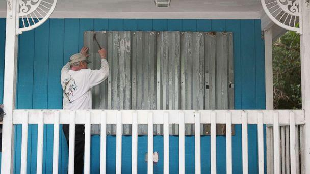 PHOTO: Mark Waddell installs hurricane shutters to a house in the Florida Keys, Sept. 6, 2017, in Islamorada, Fla.  (Marc Serota/Getty Images)