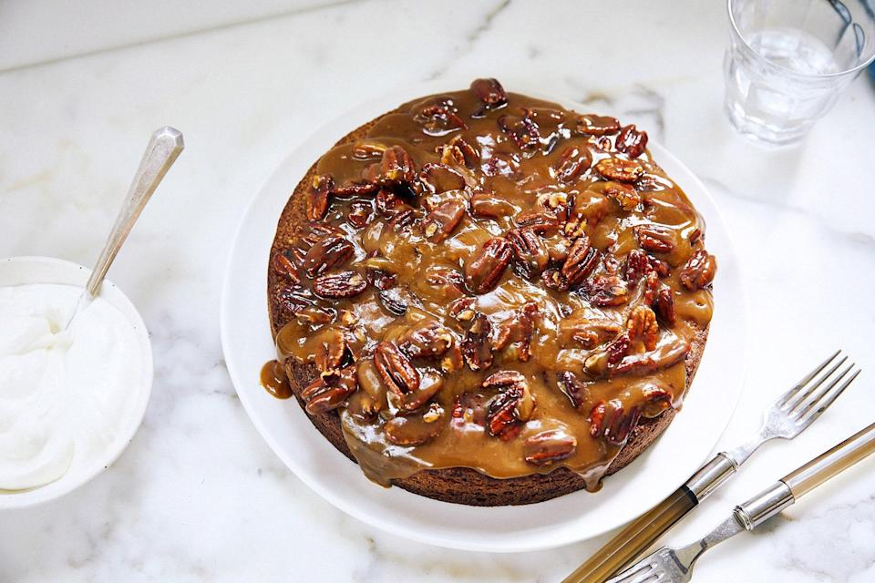 """This eats like a cross between a pecan pie, sticky toffee pudding, and a butterscotch sundae. <a href=""""https://www.epicurious.com/recipes/food/views/toasted-pecan-torte-with-butterscotch-topping?mbid=synd_yahoo_rss"""" rel=""""nofollow noopener"""" target=""""_blank"""" data-ylk=""""slk:See recipe."""" class=""""link rapid-noclick-resp"""">See recipe.</a>"""