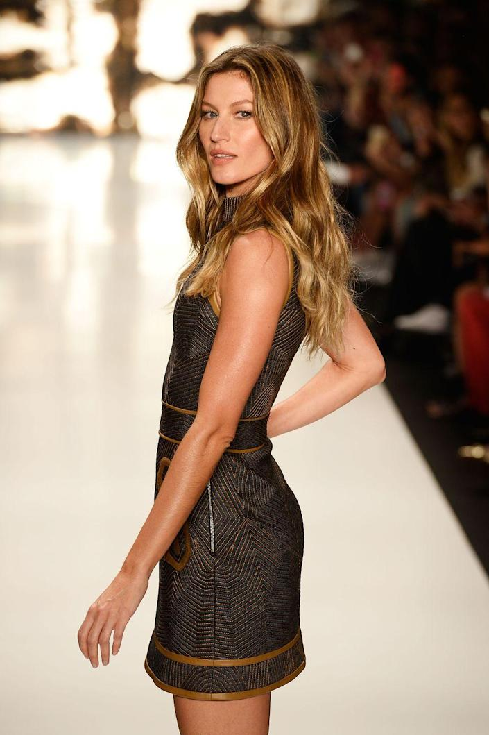 """<p><em>Forbes</em>'s longtime highest-paid model in the world was discovered while shopping in São Paolo, Brazil, <em><a href=""""http://www.independent.co.uk/life-style/fashion/features/gisele-bndchen-business-model--it-takes-more-than-just-good-looks-to-get-to-the-top-8782676.html"""" rel=""""nofollow noopener"""" target=""""_blank"""" data-ylk=""""slk:The Independent"""" class=""""link rapid-noclick-resp"""">The Independent</a> </em>reported<em>. </em>After walking her first runway at the age of 14, Bündchen went on to become the breakout supermodel of the late '90s and early 2000s, after making her big break at Alexander McQueen's spring 1998 show. </p><p>She has since dabbled in acting, appearing in movies like <em>The Devil Wears Prada</em> and <em>Taxi</em><em>,</em> and most recently wrote a memoir, <em><a href=""""https://www.amazon.com/dp/052553864X/?tag=syn-yahoo-20&ascsubtag=%5Bartid%7C10051.g.35333735%5Bsrc%7Cyahoo-us"""" rel=""""nofollow noopener"""" target=""""_blank"""" data-ylk=""""slk:Lessons: My Path to a Meaningful Life"""" class=""""link rapid-noclick-resp"""">Lessons: My Path to a Meaningful Life</a>.</em><br></p>"""
