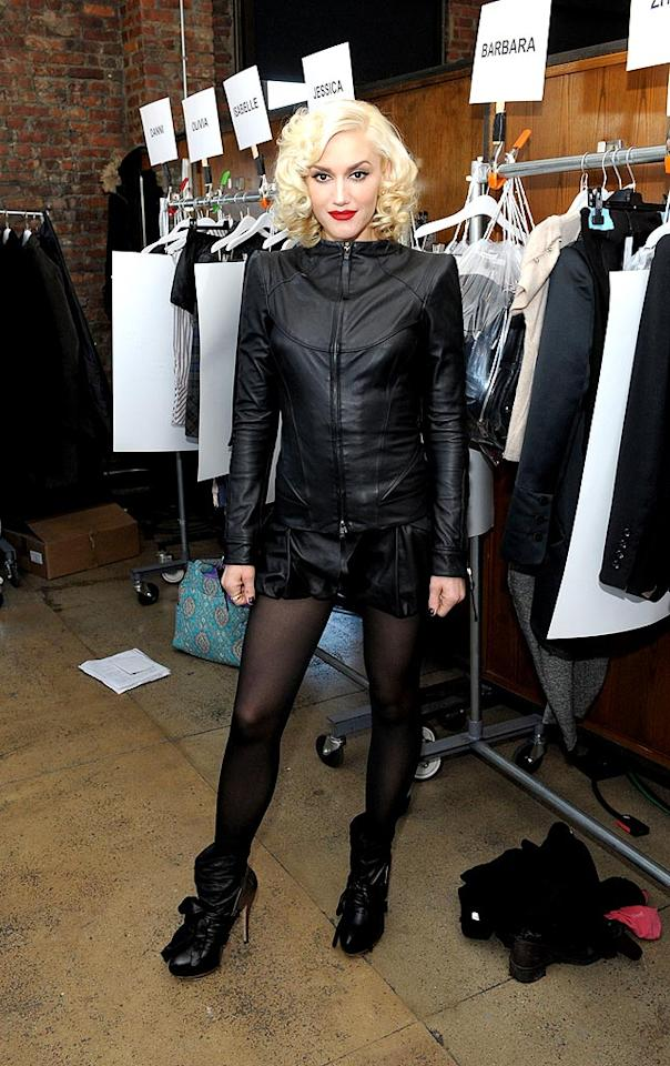 """But Kelly wasn't the only beautiful blonde in attendance. L.A.M.B. designer Gwen Stefani popped a pose in a sexy leather jacket and micro mini skirt alongside her Fall 2010 collection minutes before she sent the gorgeous garments down the runway. Andrew H. Walker/<a href=""""http://www.gettyimages.com/"""" target=""""new"""">GettyImages.com</a> - February 11, 2010"""