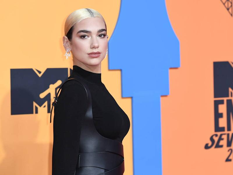 Dua Lipa showcases high-fashion looks in sitcom-inspired video