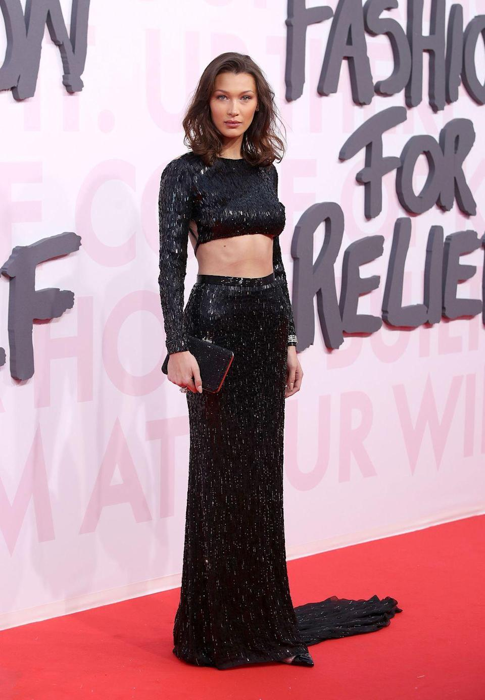 <p>The model sported a sparkly black gown that had a cutout at the midriff for the Fashion For Relief party, May 2018.</p>