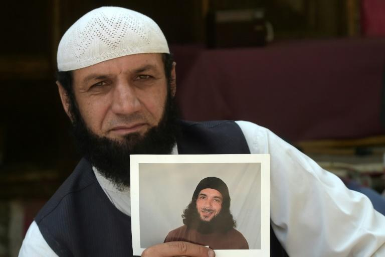 IAfghan refugee Roman Khan displays a photograph of his brother Asadullah Haroon Gul, who is detained in Guantanamo Bay detention camp.