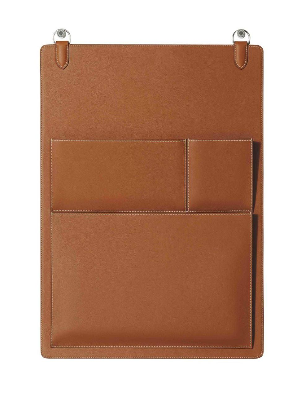 """<p>For the home office that has everything, this leather organiser from Hermès is a handbag for your paperwork. Made with bull-calf and goatskin, its is stitched together by hand in the same manner as the fashion house's iconic 'Kelly' bag. £11,500, <a href=""""https://www.hermes.com/uk/en/category/home/objects/#