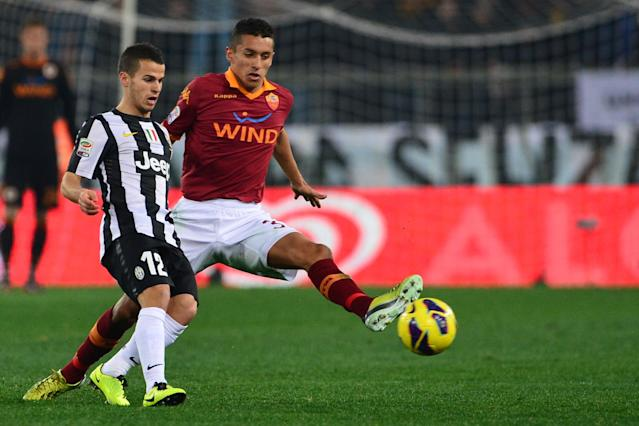 AS Roma defender Marquinhos (R) fights for the ball with Juventus' forward Sebastian Giovinco during the Italian Serie A football match between AS Roma and Juventus on February 16, 2013 at the Olympic Stadium in Rome. AFP PHOTO / GIUSEPPE CACACEGIUSEPPE CACACE/AFP/Getty Images