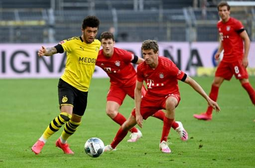 Sancho (L) has scored 14 Bundesliga goals this season
