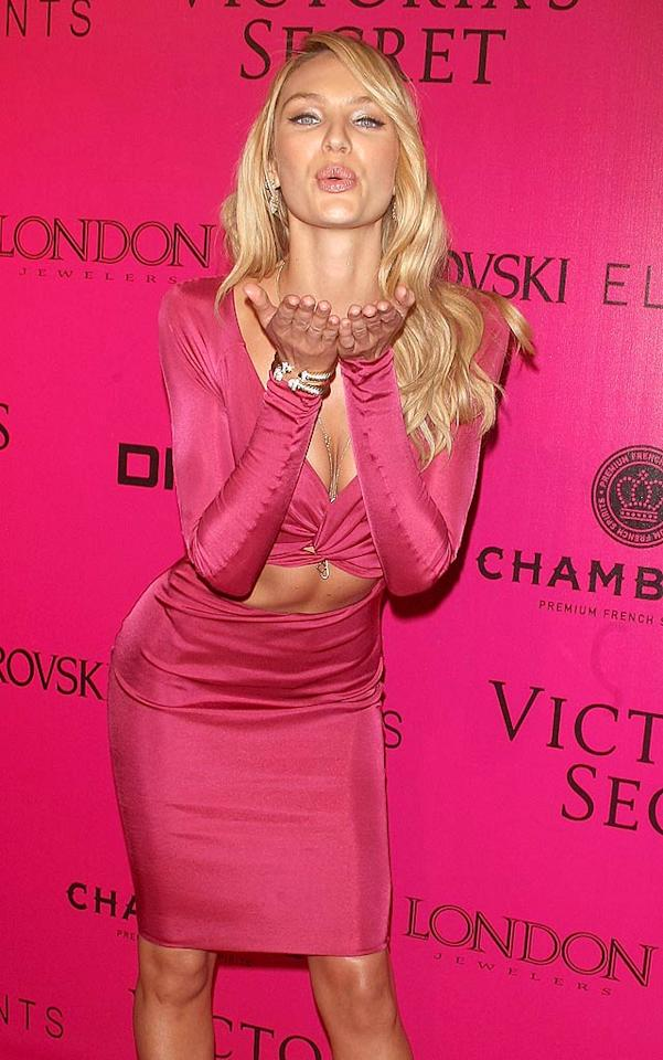 Model Candice Swanepoel donned the brand's signature color and blew the camera a kiss. (11/9/2011)