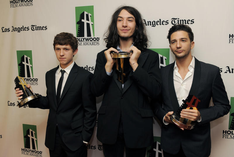 Actors Tom Holland, left, Ezra Miller, center, and John Magaro, recipients of the Hollywood Spotlight Award, pose together backstage at the 16th Annual Hollywood Film Awards Gala on Monday, Oct. 22, 2012, in Beverly Hills, Calif. (Photo by Chris Pizzello/Invision/AP)