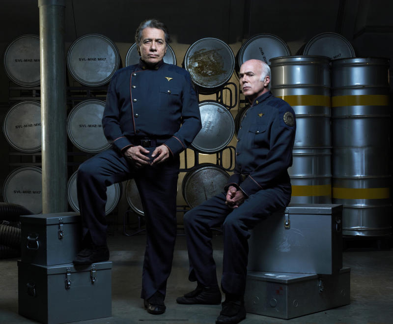 BATTLESTAR GALACTICA -- Season 3 -- Pictured: Edward James Olmos as Admiral William Adama, Michael Hogan as Colonel Saul Tigh -- (Photo by: Justin Stephens/Syfy/NBCU Photo Bank/NBCUniversal via Getty Images)
