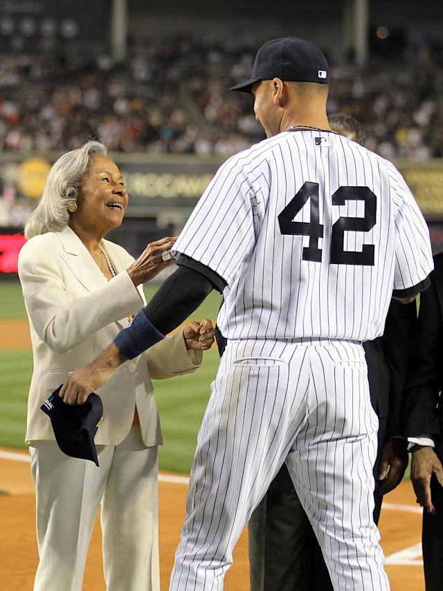 NEW YORK, NY - APRIL 15: Rachel Robinson, wife of Jackie Robinson, welcomes Derek Jeter of the New York Yankees to an on field ceremony prior to their game against the Los Angeles Angels of Anaheim at Yankee Stadium on April 15, 2012 in the Bronx borough of New York City. In honor of Jackie Robinson Day, all players across Major League Baseball will wear number 42(Photo by Nick Laham/Getty Images)