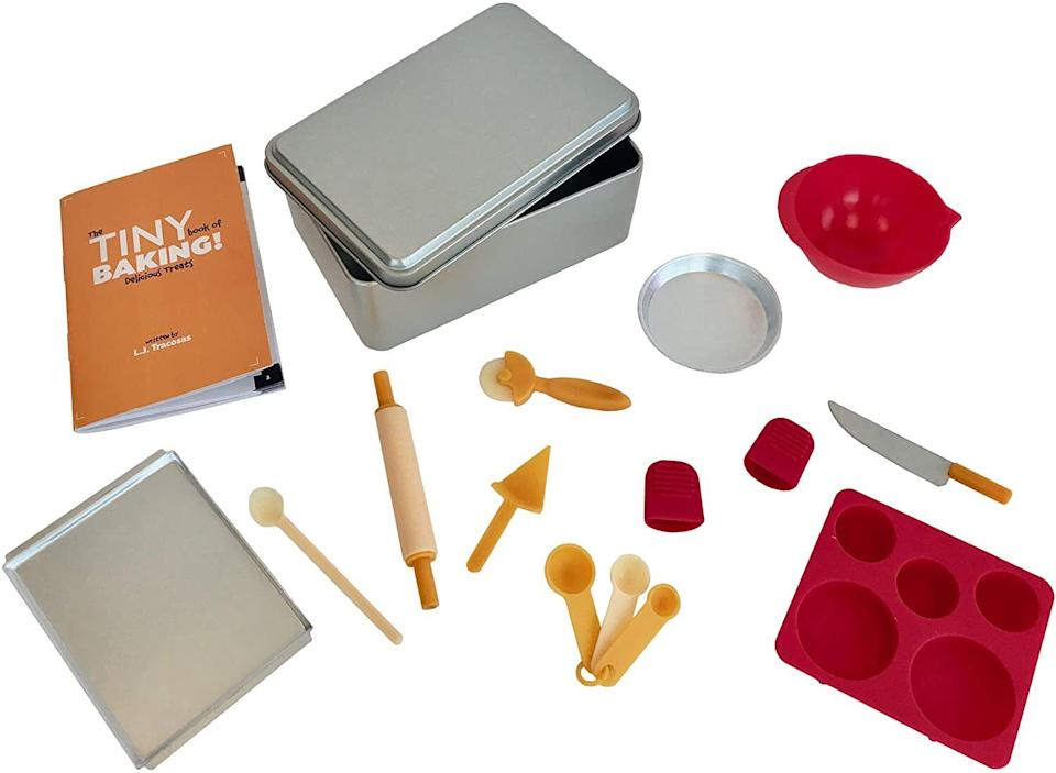 """Whip up cute bite-sized sweets whenever you and your little ones are in the mood for some dessert!<br /><br />This set comes with a storage tin, rolling pin, wee knife, pizza/dough cutter, mixing spoon, three wee spoons, mixing bowl, pizza/pie pan, pie server, sheet pan, silicone cake and cupcake molds, two silicone finger mitts and a 48-page recipe book.<br /><br /><strong>Promising review:</strong>""""I gave this to my sister for Christmas and she immediately used it to make mini treats with the kids. They LOVE it! I just kept getting texts and pictures from them about how functional and FUN it is."""" —<a href=""""https://amzn.to/3wlMaM9"""" target=""""_blank"""" rel=""""nofollow noopener noreferrer"""" data-skimlinks-tracking=""""5851345"""" data-vars-affiliate=""""www.tastemade.com"""" data-vars-href=""""https://www.amazon.com/gp/customer-reviews/R2JRZG9EAF0LTC?tag=bfnusrat-20&ascsubtag=5851345%2C14%2C34%2Cmobile_web%2C0%2C0%2C16317608"""" data-vars-keywords=""""cleaning"""" data-vars-link-id=""""16317608"""" data-vars-price="""""""" data-vars-product-id=""""20939324"""" data-vars-product-img="""""""" data-vars-product-title="""""""" data-vars-retailers=""""Amazon"""">Leslie Palmer<br /><br /></a><strong><a href=""""https://amzn.to/2S2tbqT"""" target=""""_blank"""" rel=""""noopener noreferrer"""">Get it from Amazon for$19.99.</a></strong>"""
