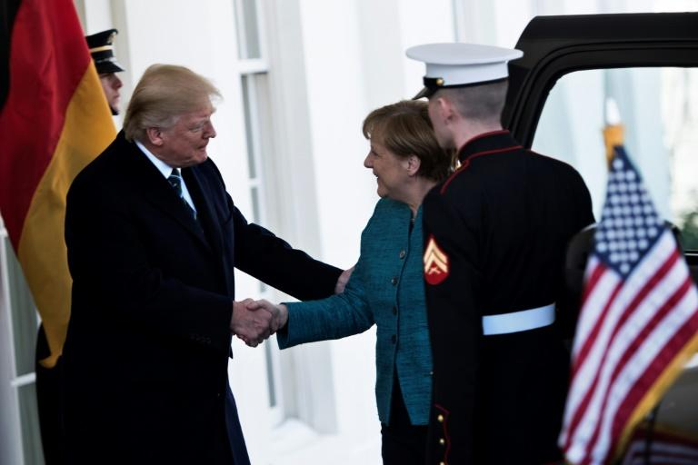 A White House visit by German Chancellor Angela Merkel began cordially with a handshake, but later Merkel's suggestion of another one went unheard or ignored by President Donald Trump
