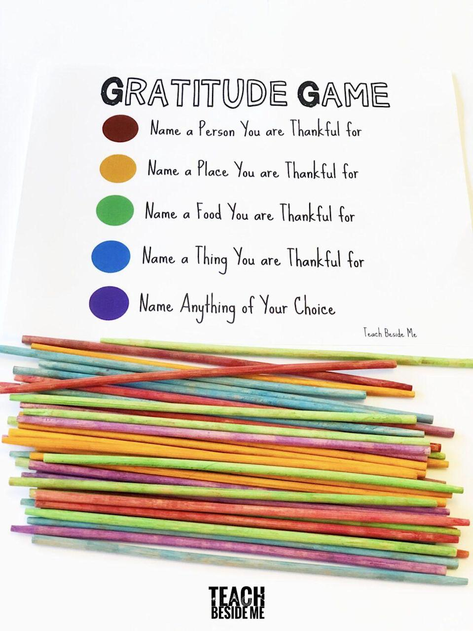 """<p>Since Thanksgiving is the perfect time to reflect on what you're most grateful for, this gratitude game is right on theme. This twist on pick-up sticks can be recreated with your choosing of each category.</p><p><strong>Get the tutorial at <a href=""""https://teachbesideme.com/gratitude-game-pick-sticks"""" rel=""""nofollow noopener"""" target=""""_blank"""" data-ylk=""""slk:Teach Beside Me"""" class=""""link rapid-noclick-resp"""">Teach Beside Me</a>. </strong></p>"""