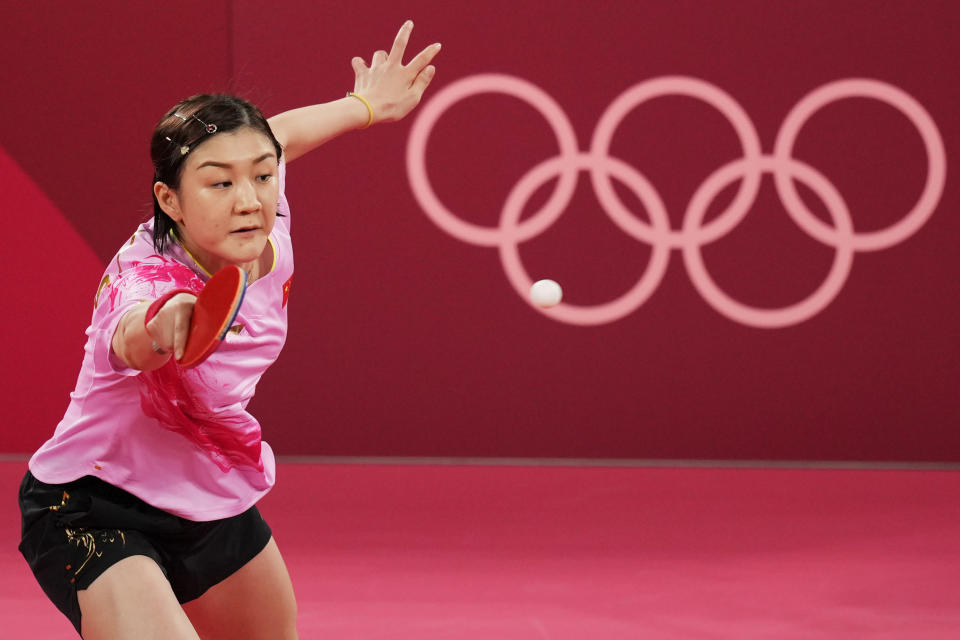 China's Chen Meng competes against countrywoman Sun Yingsha during the gold medal match of the table tennis women's singles at the 2020 Summer Olympics, Thursday, July 29, 2021, in Tokyo. (AP Photo/Kin Cheung)