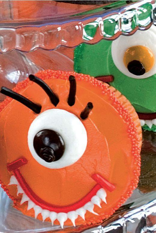 """<p>You can either make your own base cupcakes or buy plain vanilla cupcakes before decorating them like these adorable monsters.</p><p><strong><em><a href=""""https://www.womansday.com/food-recipes/food-drinks/a28860615/one-eyed-monster-cupcake-recipe/"""" rel=""""nofollow noopener"""" target=""""_blank"""" data-ylk=""""slk:Get the One-Eyed Monster Cupcake recipe."""" class=""""link rapid-noclick-resp"""">Get the One-Eyed Monster Cupcake recipe. </a></em></strong></p>"""