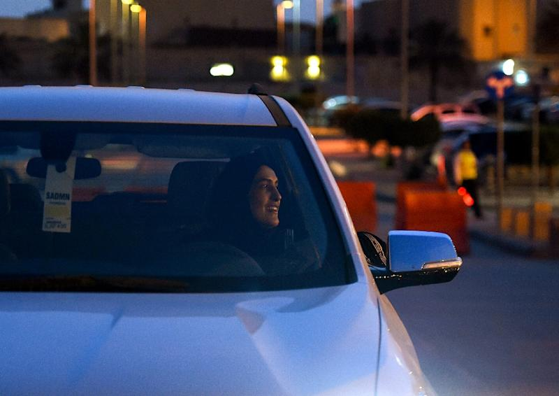 A Saudi woman test-drives a car during an automotive exhibition for women in the capital Riyadh on May 13, 2018 (AFP Photo/FAYEZ NURELDINE)