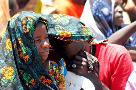 Relatives mourn as they attend the burial of dead passengers retrieved after the MV Nyerere ferry overturned off the shores of Ukara Island in Lake Victoria, Tanzania September 23, 2018. REUTERS/Stringer