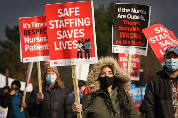 PHOTO: Registered nurses protest outside their employer, St. Mary Medical Center, in Langhorne, Pennsylvania, on Nov. 17, 2020. The nurses are on strike calling for better wages and adequate staffing amid rising COVID-19 hospitalizations. (Jessica Griffin/The Philadelphia Inquirer via AP)