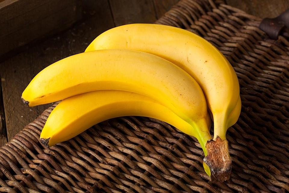 bunch of yellow bananas on wicker background