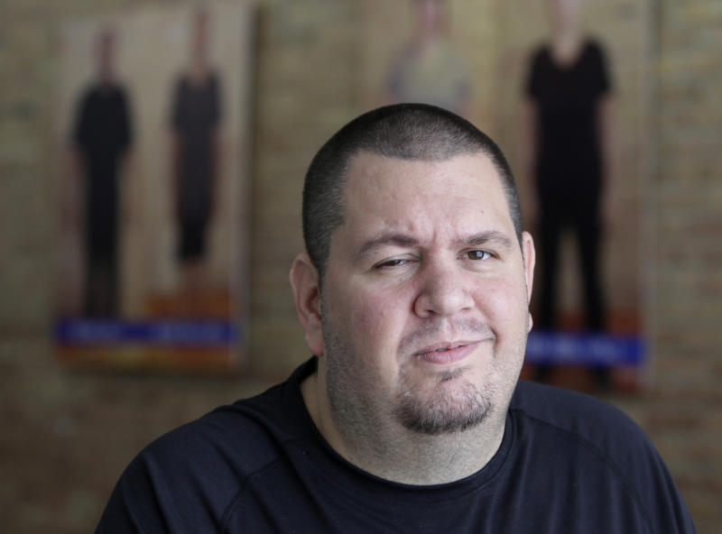 In this Dec 6, 2012 photo, Downsize Fitness founder Francis Wisniewski is seen at one of his gyms in Chicago. The gym chain he started caters exclusively to people who want to lose at least 50 pounds. (AP Photo/Teresa Crawford)
