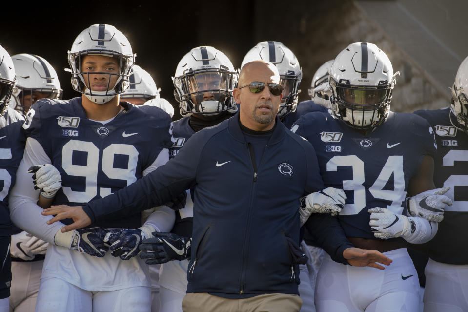Penn State head coach James Franklin leads his team onto the field for an NCAA college football game against Indiana in State College, Pa., on Saturday, Nov.16, 2019. Penn State defeated 34-27. (AP Photo/Barry Reeger)