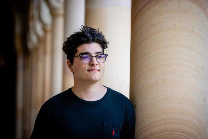 This photo taken on September 1, 2020 shows student Drew Pavlou posing for a photo on the campus of the University of Queensland in Brisbane. - When a Chinese foreign ministry spokesman personally denounced Pavlou at a recent press conference, it was just the next phase in an extraordinary campaign against the 21-year-old that has fuelled concerns over China's targeting of critics overseas. (Photo by Patrick HAMILTON / AFP) / TO GO WITH Australia-China-politics-demonstration-students,FOCUS by Holly ROBERTSON (Photo by PATRICK HAMILTON/AFP /AFP via Getty Images)