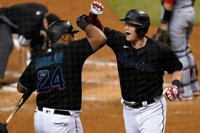 Rojas, Cooper homer to lead Marlins over Nationals 7-3