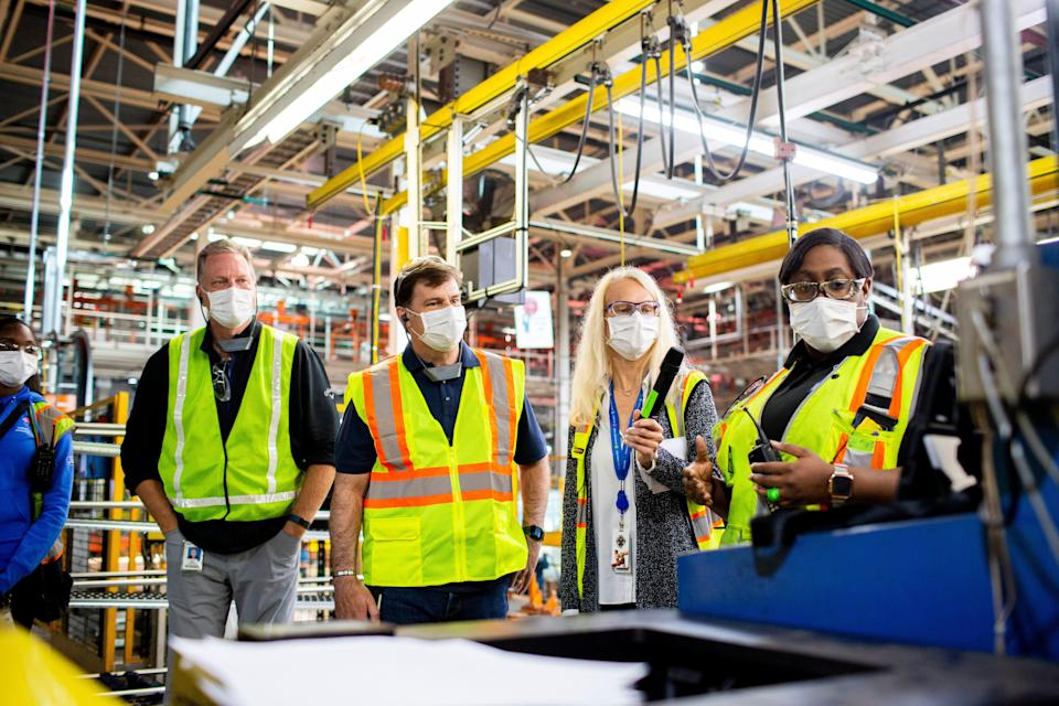 Ford engineering specialist Shaunise Williams, Gary Johnson, CEO Jim Farley, Dearborn Truck Plant Manager Debbie Manzano and launch team member Edana Jones discuss a machine operation on Sept. 25, 2020. Johnson, chief manufacturing and labor affairs officer, retired on Feb. 1, 2021.